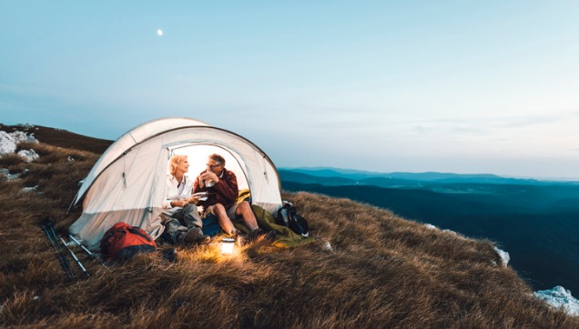 senior-couple-camping-in-the-mountains-and-eating-a-snack-636x362.jpg
