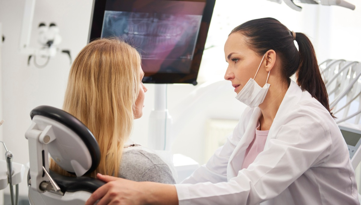 dentist-talking-to-worried-woman-during-dental-checkup-picture-1200x683.jpg