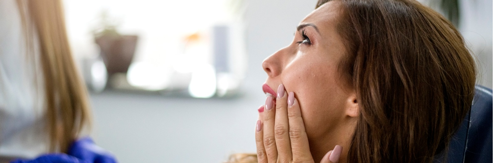 young-woman-with-toothache-picture-1600x529.jpg