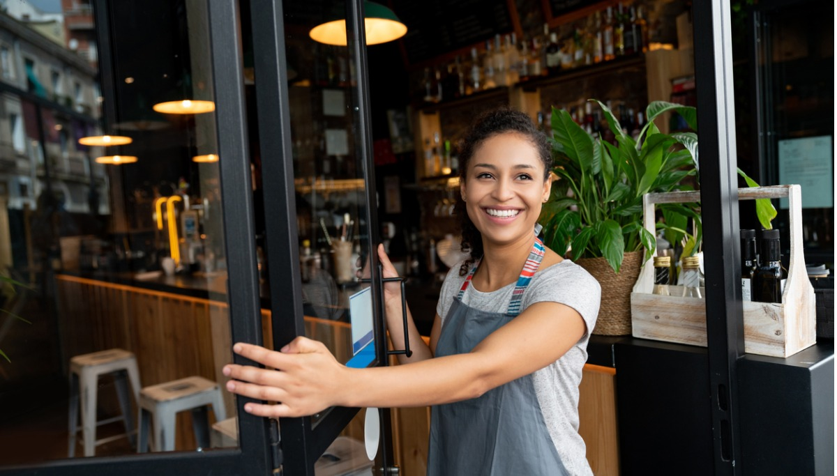 happy-business-owner-opening-the-door-at-a-cafe-picture-1200x683.jpg