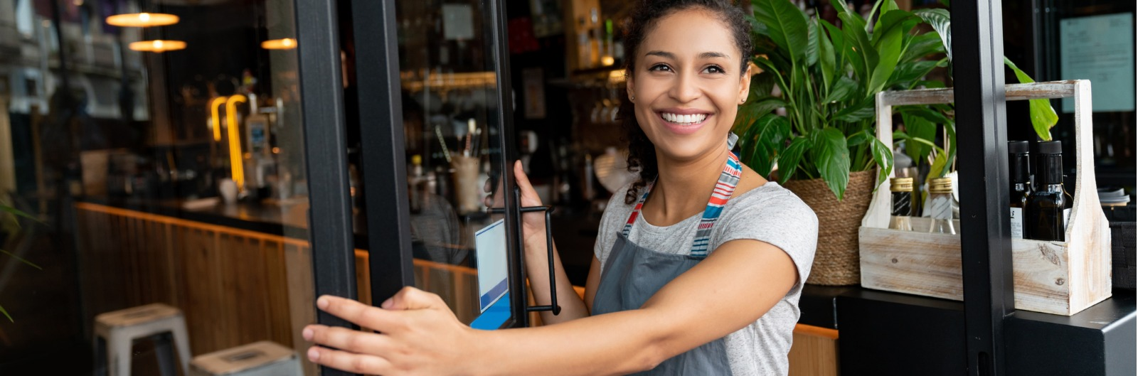 happy-business-owner-opening-the-door-at-a-cafe-picture-1600x529.jpg