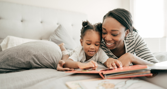 Mother and child reading in bed