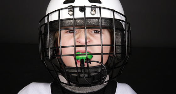 boy football player with mouth guard
