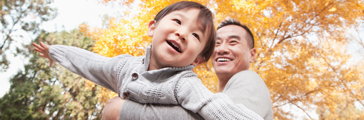 Father and son in fall leaves