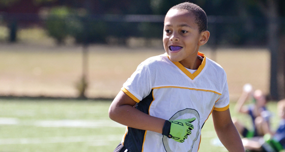 Boy playing soccer with mouth guard