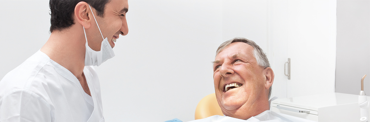 Patient talking with dentist
