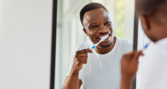 Guy brushing teeth