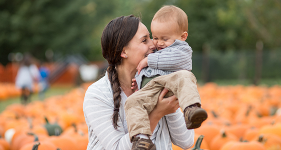 Mom and son at pumpkin patch
