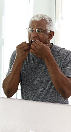 Older man flossing