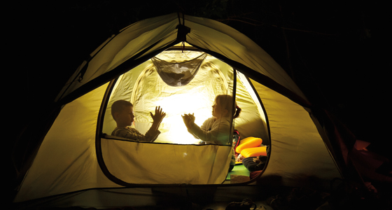 Kids in a tent at night