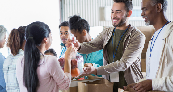 People serving resources at a food bank