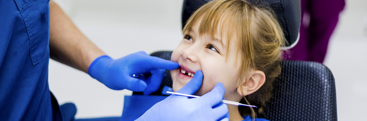 11476-7-Girl at dentist-1242x411.jpg