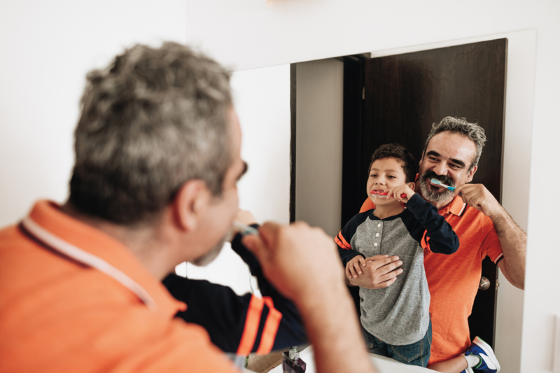 Father-and-son-brushing-teeth-800x533.jpg