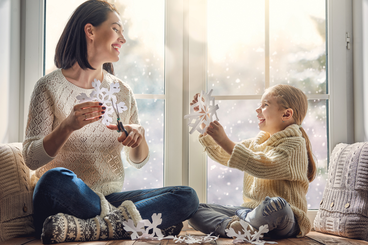 Mother-and-daughter-cutting-snowflakes-1200x800.jpg